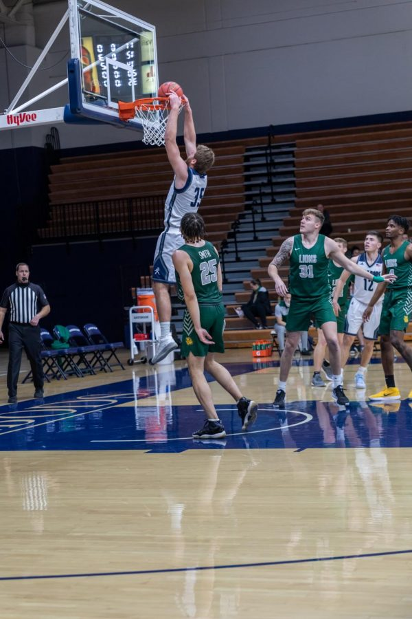 Slammin' and Jammin': Washburn's senior forward Jace Williams slam dunking the ball. Williams had a total of six points in Thursday's game against MSSU.