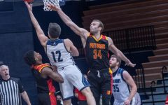 Put it through for two: Washburn's senior guard Tyler Geiman driving the ball to the basket for two points. Geiman had a total of 19 points against the Pittsburg State Gorillas.