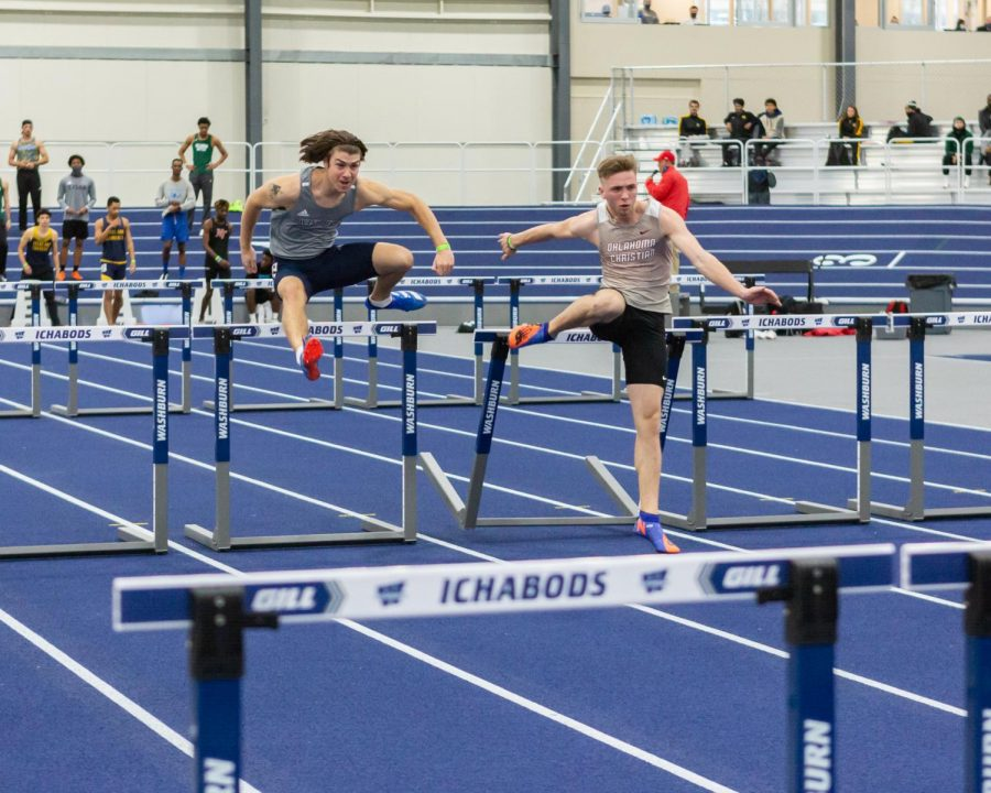 Washburn's Dalton White clears the hurdle in the 60 meter hurdles. White placed 24th with a time of 9.40 seconds.