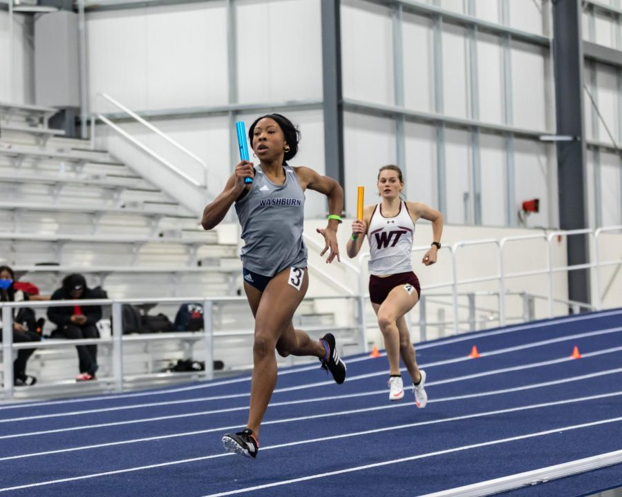 In it to win it: Washburn's Chia Okoro digging deep to keep her teams position in the 4x400 relay. Okoro was the first leg in the women's 4x400 on Saturday, Jan. 30 at the Washburn Open track meet.