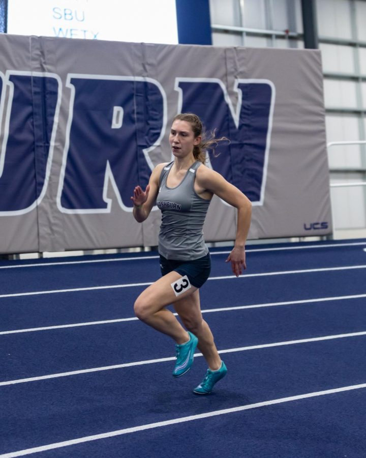 Every Day I'm Hustlin': Ichabod Darian Hillebert sprinting around the track in the women's 200-meter dash. Hillebert placed 17th in the competition with a time of 26.06 seconds on Saturday, Jan. 30 at the Washburn Open track meet.