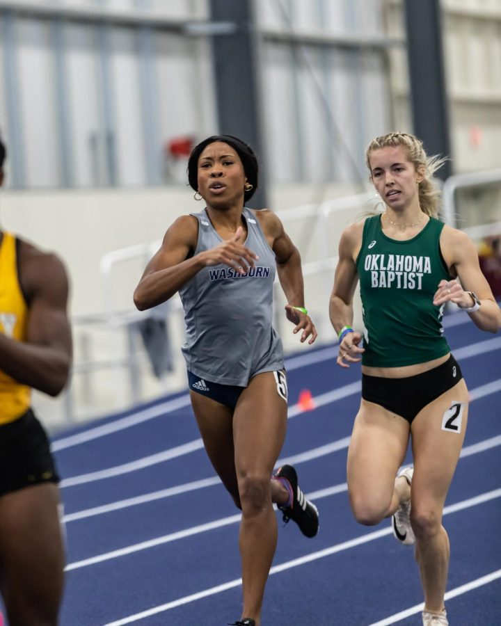 Washburn's Chia Okoro feels the burn as she nears the finish line in the 400-meter dash. Okoro placed 8th with a time of 1:00.10 during Saturday's competition.