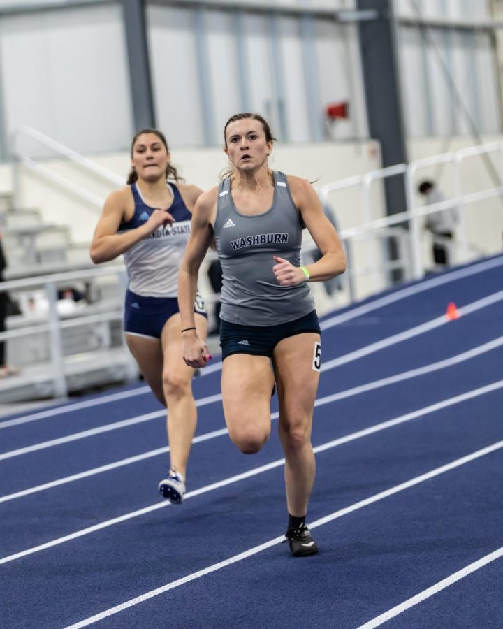 Ghost Runner: Ichabod Lyndsay Stinson digging deep to power through to the finish line of the 400-meter. Stinson finished in 5th place with a time of 59.62 seconds during the Washburn Open competitions on Saturday.