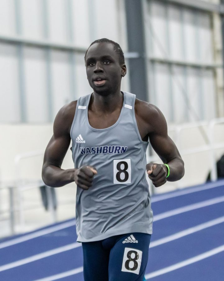 Washburn's Gabriel Chinya runs into 17th place in the men's 3K with a time of 8:59.93 during day two of the Washburn Open.