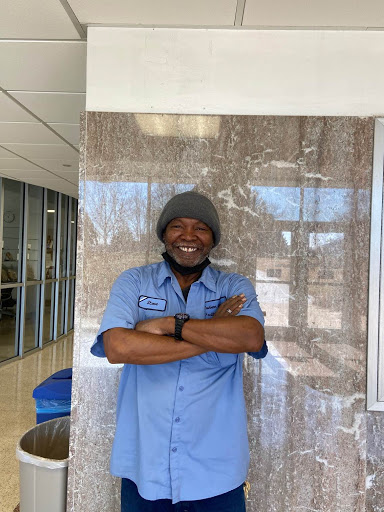 Keeping the campus clean: A mask doesn't stop Steve from shining a smile to help lift the spirits of Washburn students. But for this photo, Steve was able to show people the smile behind the mask.