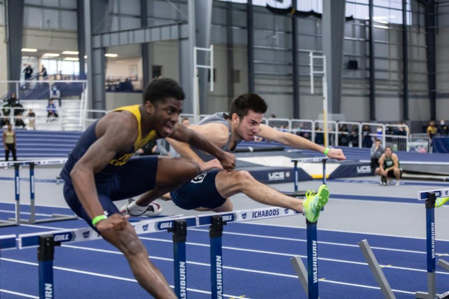 Washburn's Romain Henry leaps over the hurdles on his way to the finish line. Henry placed 3rd in the men's 60-meter hurdles with a time of 8.13 seconds.