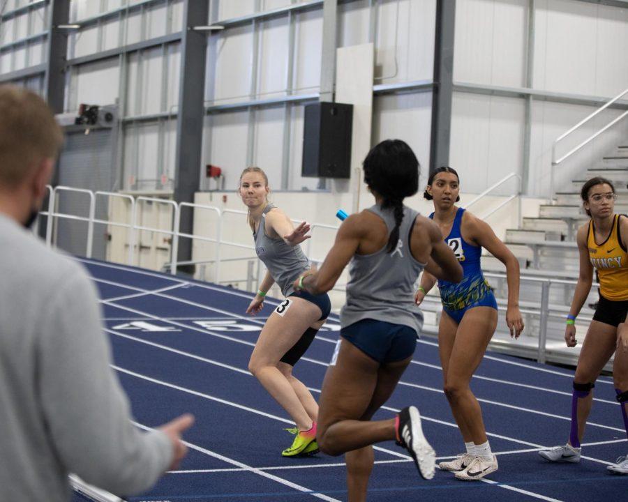 Team Ichabod: Nikki Kraaijeveld taking the baton from teammate Chia Okoro in the women's relay.