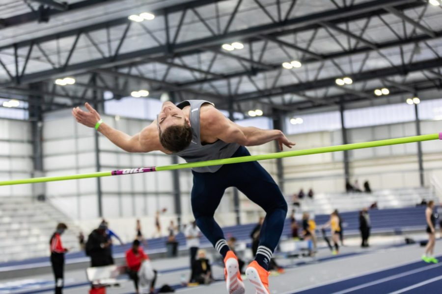 Mad Hops: Ichabod Tom Haug clears the bar in the high jump. Haug came in 5th with a height of 6 feet and 2.409 inches. Haug said,
