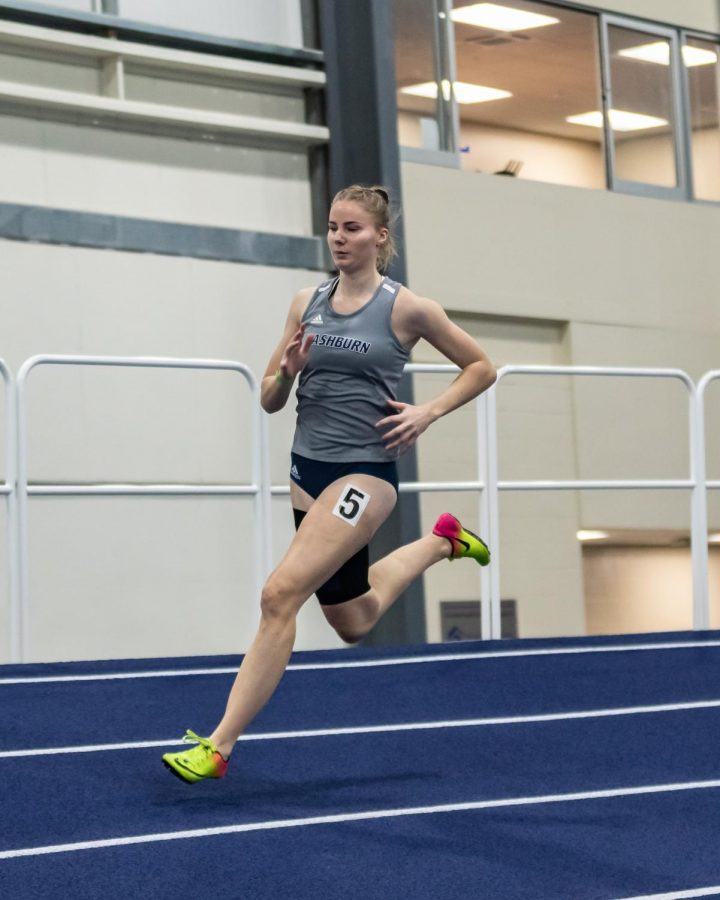 Kick it: Washburn's Nikki Kraaijeveld running in the women's 400-meter dash. Kraaijeveld finished 24th with a time of 1:01.63 in the Washburn Open on Saturday's track meet.