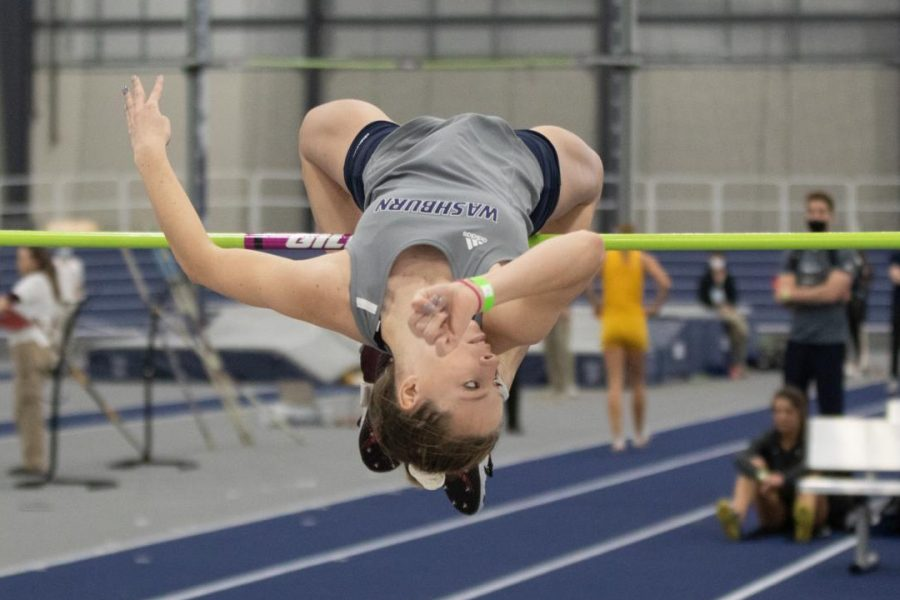 "No limits: Skyler Saunders flies over the bar of the high jump. Saunders placed 6th with a jump of 5 feet and 3.78 inches. "" I have been doing the high jump since the sixth grade,"" said Saunders."
