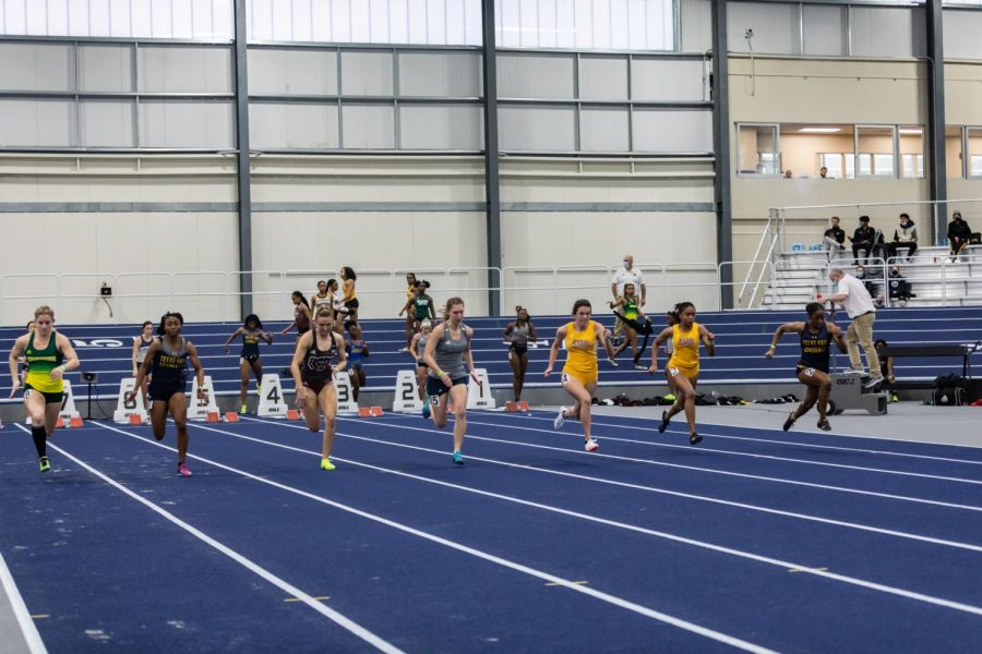 Just Run: Washburn's Darian Hillebert sprinting out of the blocks in the 60-meter dash. Hillebert finished in 22nd place with a time of 8.04 seconds during the Washburn Open track and field competitions.