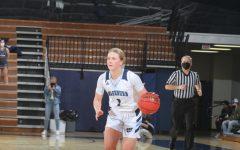 Break through: Freshman guard Mackenzie Gamble drives the ball against Emporia State University.
