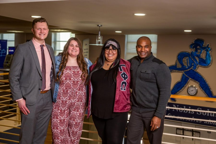 All Smiles: (from left to right) Dylan Babcock, Abby Trautman, Victoria Smith and Isaiah Collier pose for a photo. Each one has contributed to the growth and development of Washburn.