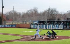 Good hit: Second baseman Tyler Clark-Chiapparelli sends a pitch from Northeastern State University into center field.
