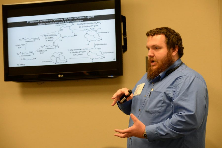 Science stuff: Washburn's Paul Heffren who majored in Molecular Biology presents his knowledge at the 2019 Apeiron.