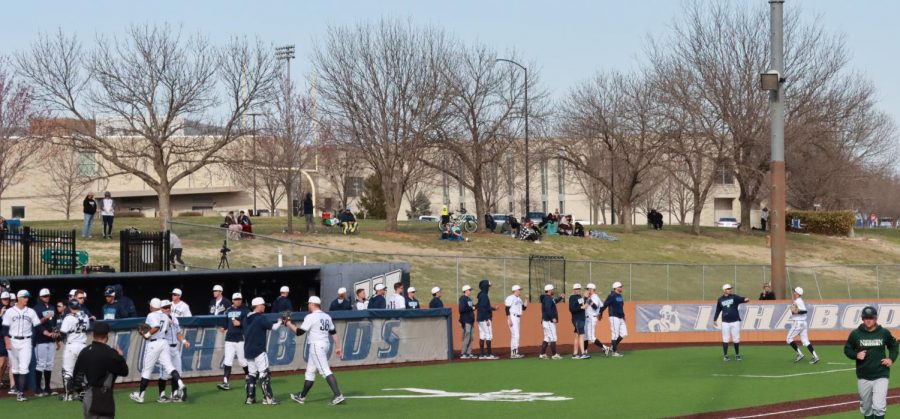Welcome back: The Washburn bench greets fielders after completing an inning.