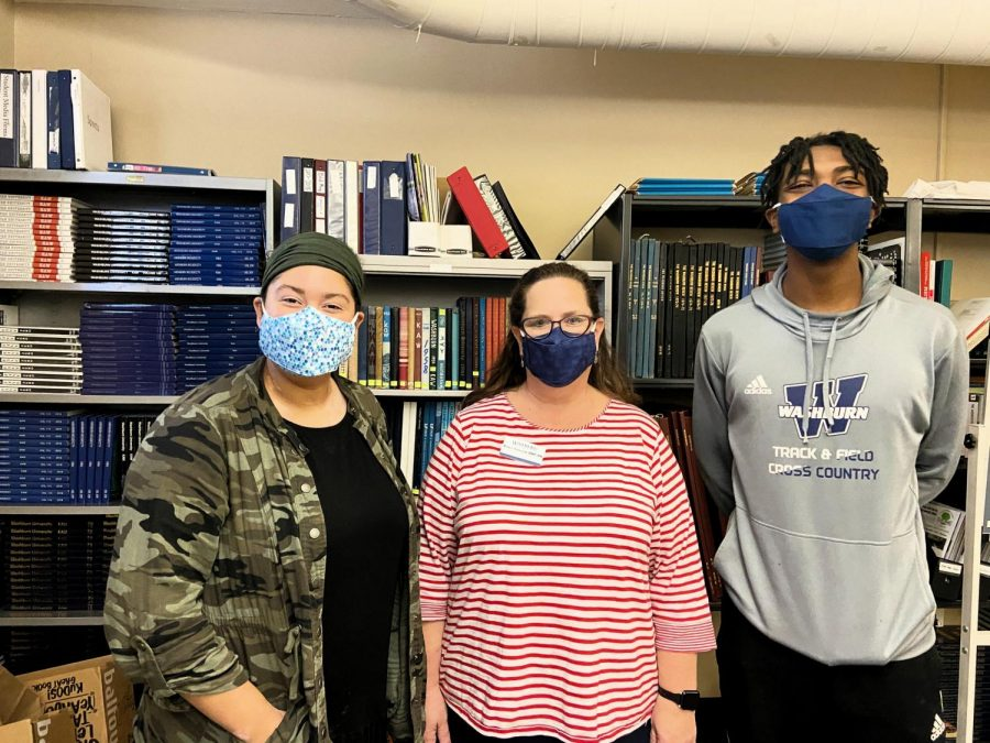Need a mask? Dr. Debbie Isaacson standing with student media staff Anna-Marie Lauppe (left) and Eric Patterson (right). All three are wearing some of Dr. Isaacson