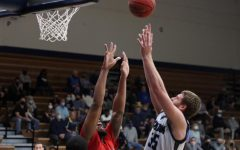 High jump: Senior forward Jace Williams puts up a shot against Rogers State University.