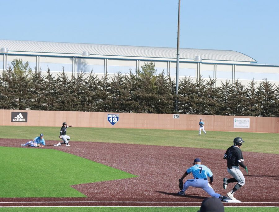 Good catch: First baseman Eric Hinostroza receives a throw to complete a double play.