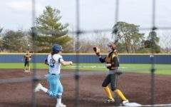 Go for it: Sophomore right-fielder Maddie Stipsits races to first base to try to beat out a ground ball.