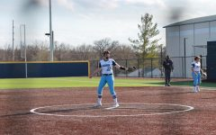 Get loose: Junior pitcher Raegen Hamm warms up before an inning to face the Fort Hays State University hitters.