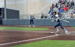 Make the connection: Freshman shortstop Hadley Kerschen sends a ball into right field for a single in the third inning.