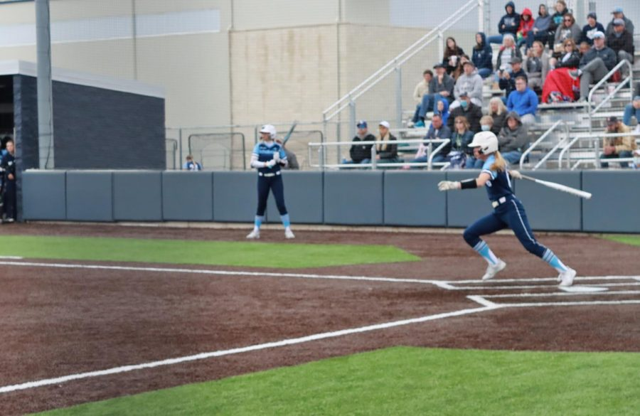 Make+the+connection%3A+Freshman+shortstop+Hadley+Kerschen+sends+a+ball+into+right+field+for+a+single+in+the+third+inning.