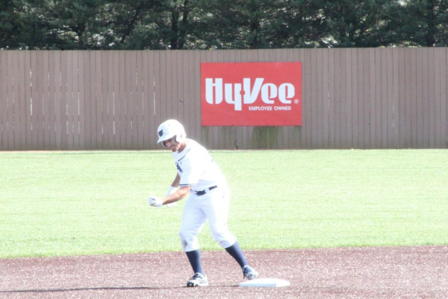 Big hit: Senior outfielder Peter Shearer pumps his fist after doubling in Washburn's 13-10 loss against Emporia State.