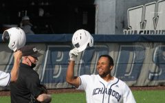 Tip of the cap: Zion Bowlin celebrates at home plate after hitting a two-run home run in the third game of Washburn's series versus Rogers State.