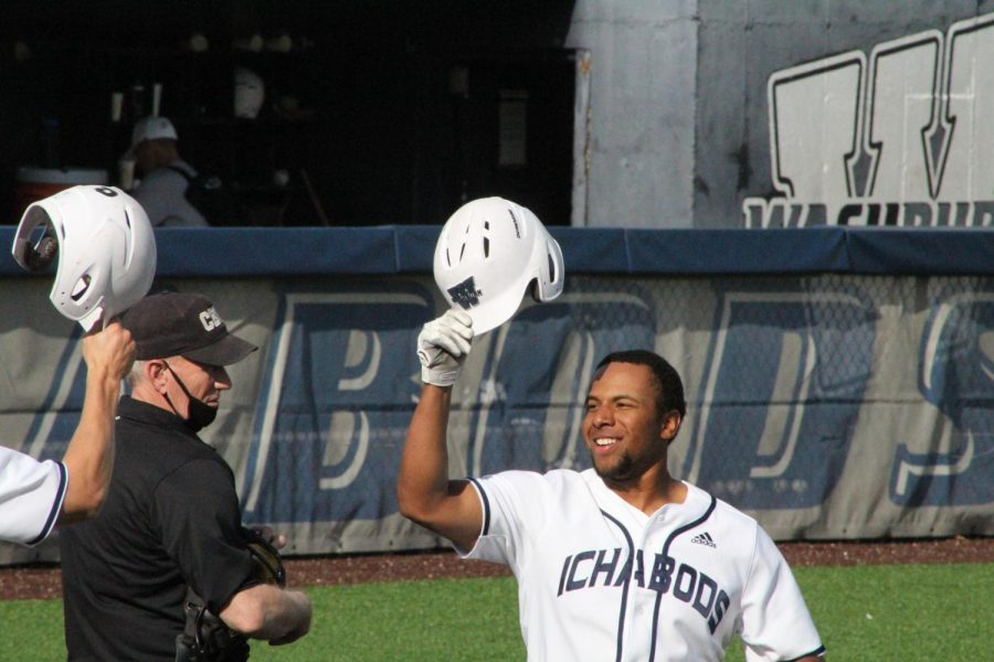 Tip of the cap: Zion Bowlin celebrates at home plate after hitting a two-run home run in the third game of Washburn