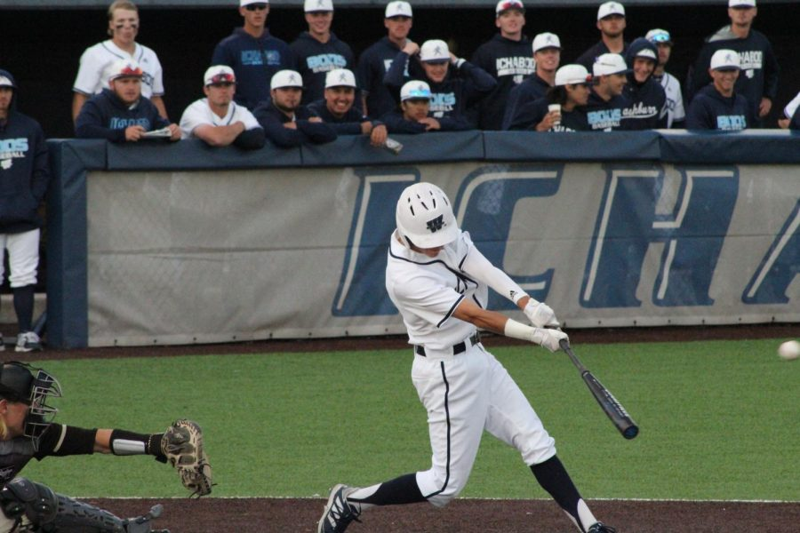 Barrel it up: Senior outfielder Cole Emerson sends a sacrifice fly into the outfield to score a run in Washburn
