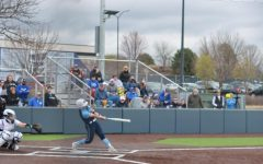 That's a hit: Junior catcher Bri Francis sends a ball into center field in the Ichabods 7-6 victory over the University of Nebraska at Kearney.