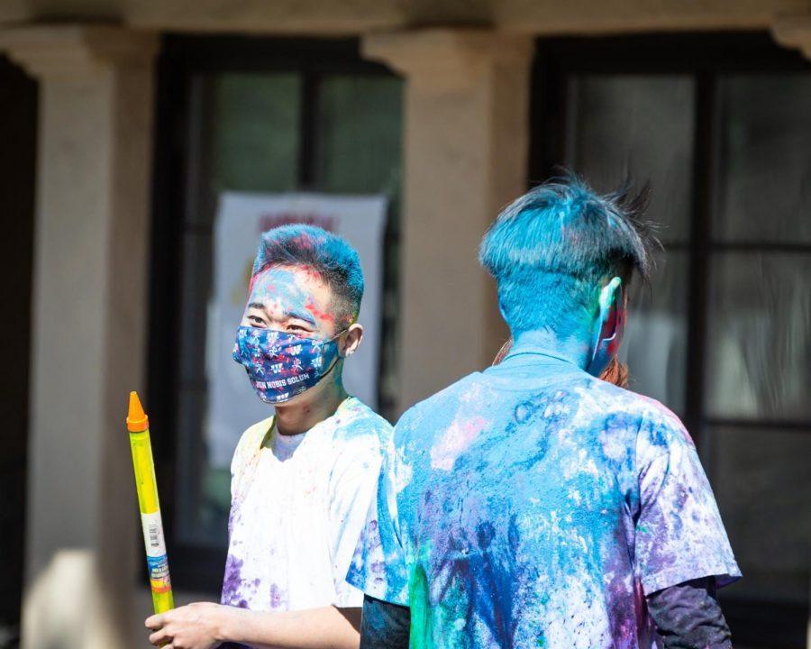 Feeling Blue?: Junnosuke Saito and Yusuke Takahashi getting covered in Holi powder during the Holi Festival at Washburn University. Both Junnosuke and Yusuke are from Japan.