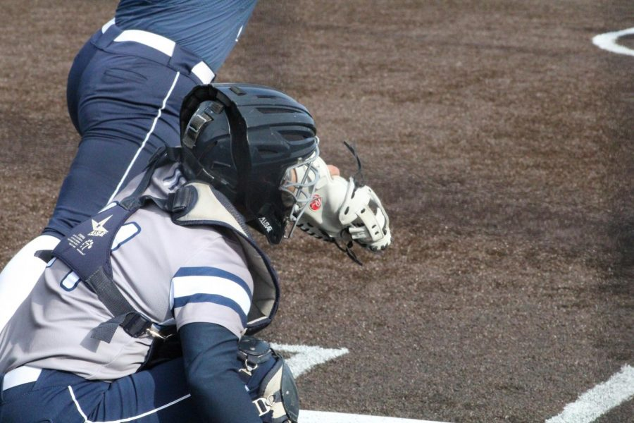 Down and ready: Bri Francis receives a pitch in game two of Washburn's double-header sweep over Lincoln.