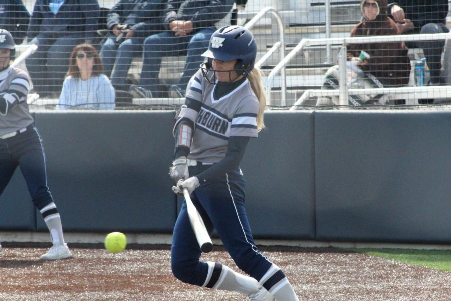 Swing Away: Brianna Fuchs sends a ball into center field for a single in game one of Washburn