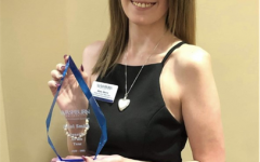 Ariel Smith stands proud after receiving the 2021 senator of the year award from WSGA