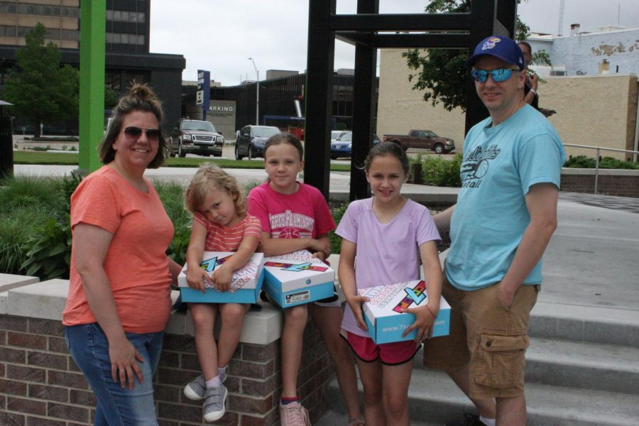 Family outing: (from left to right) Rachel, Corey, Zoey, McKenna and Ronnie get some new shoes courtesy of T-Rell. Ronnie and Rachel's kids appreciated the gifts before heading out for the day.