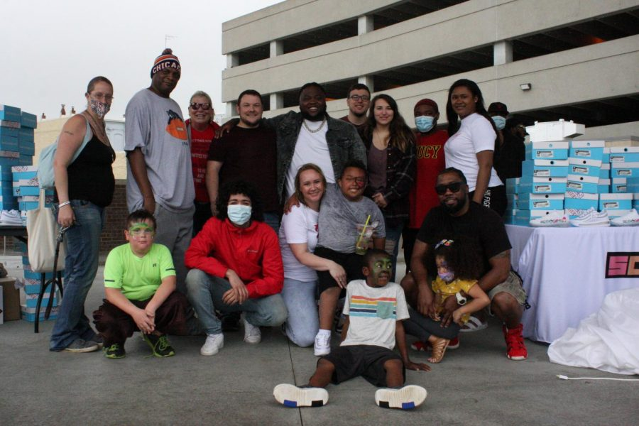 Get together: T-Rell, many family members, assistants and other attendees gather together for a group photo. The shoe giveaway was a great opportunity to bring the community together.