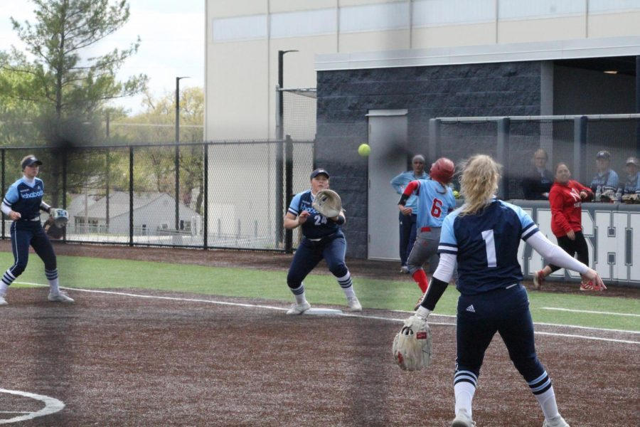 Routine play: Kamryn Garvie receives a throw from Marrit Mead to record an out in game two of the double-header against Newman.