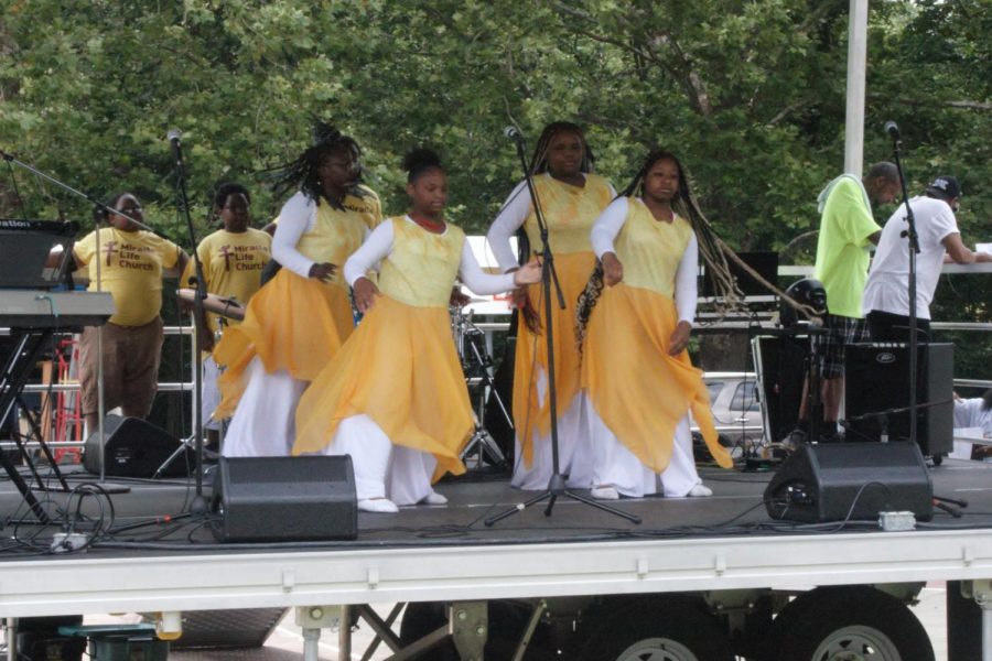 Move your feet: Performers from the Miracle Life Church dance on stage while music plays in the background. Many performances took place throughout the day featuring other local groups and musicians.