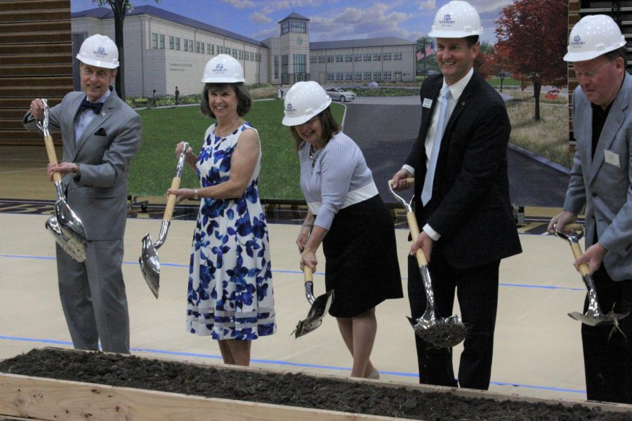 Let it Begin!: Ground broken, work can now begin on the construction of the new building. Farley and the other alumni members looked happy as they dug with their shovels.