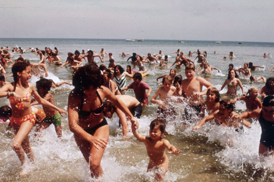 Clearing the water: Amity Island beach-goers run for dry land after spotting the great white shark.