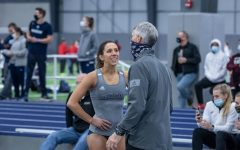 Run fast, vault high: Washburn's senior pole vaulter Virgi Scardanzan talking with assistant coach Rick Attig after a great vault. She always gives 100% each time she pole vaults.