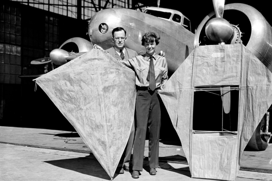 Not all fun & games: Amelia Earhart Putnam and George Putnam show off large kites. Earhart planned to use these as distress signals so searchers could locate her easier if disaster struck. This photo was taken 10 days prior to her around-the-world trip.