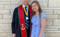 Caleb Phelps and his girlfriend, Mercedes Elias, pose for a picture at graduation.