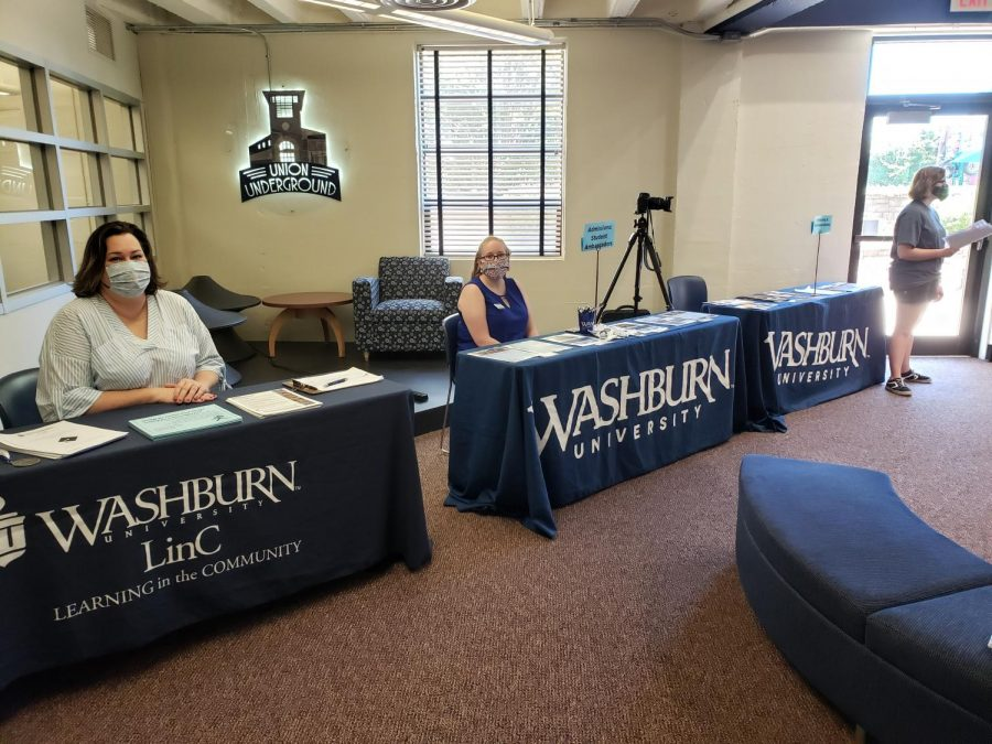 Apply here: Jenny Lieurance (left) and Petra Gay (right) eagerly wait for students to arrive.