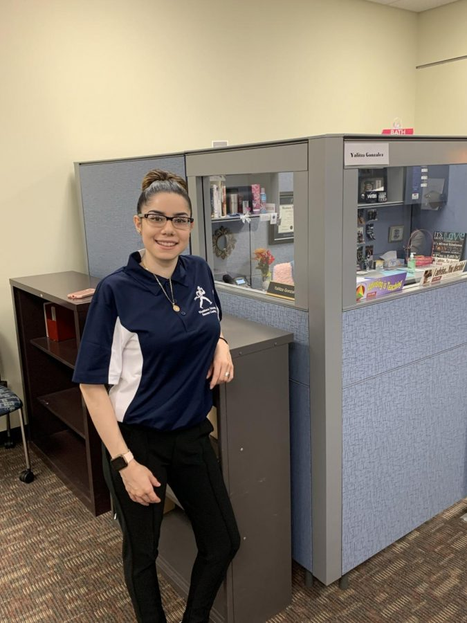 Home away from home: Yalitza Gonzalez at her cubicle in Mabee Library.