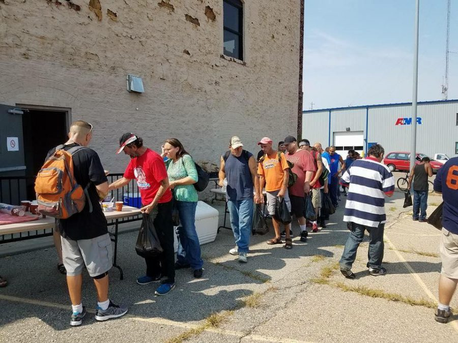 Lead.+Help.+Build.+Protect%3A+Topeka+volunteers+provide+hot+meals+for+those+in+need+every+Sunday
