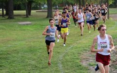 Leading the pack: Cooper Griffin leads the pack of runners around corner 8 on Sept. 24, 2021. Griffin finished 37th in the race, earning 31 points for the team.