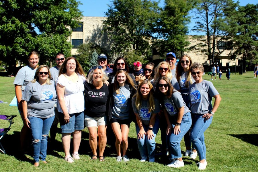 Sorority squat: Zeta Tau Alpha families pose together at Family Day. ZTA had a tailgate set up with food and fun.